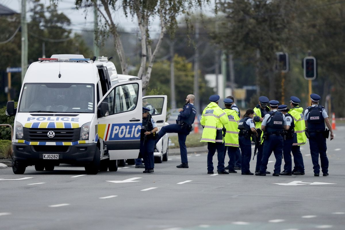 Police gather outside the Linwood mosque, site of one of the mass shootings at two mosques in Christchurch, New Zealand, Saturday, March 16, 2019.