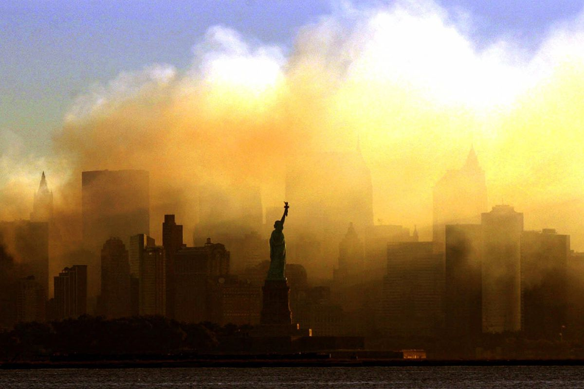 The Statue of Liberty stands as seen on Sept. 15, 2001, in front of a smoldering lower Manhattan at dawn as seen from Jersey City, N.J.