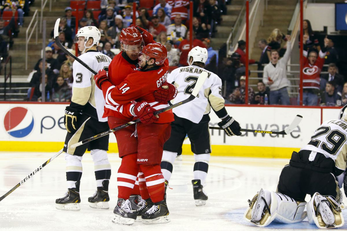 Nathan Gerbe and Alex Semin celebrate Gerbe's goal against the Pens.