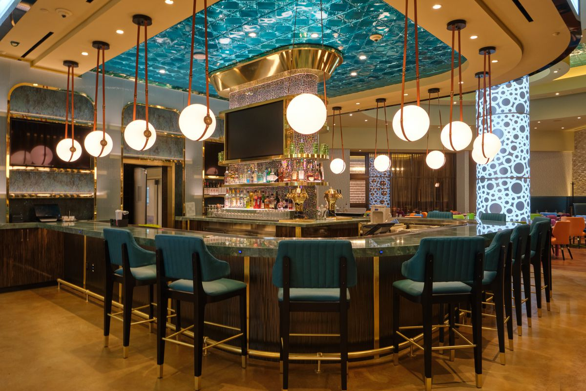 A bar with blue chairs