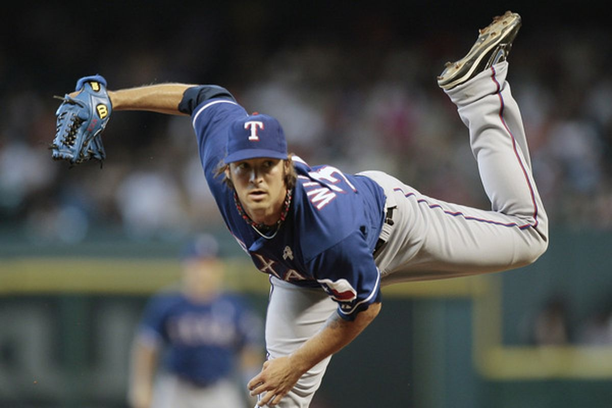 HOUSTON - JUNE 20:  Pitcher C.J. Wilson #36 of the Texas Rangers throws in the first inning against the Houston Astros at Minute Maid Park on June 20, 2010 in Houston, Texas.  (Photo by Bob Levey/Getty Images)
