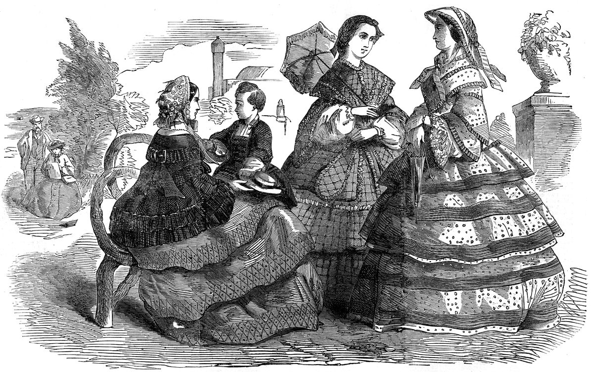 three women in large hooped caged crinoline dresses with one child