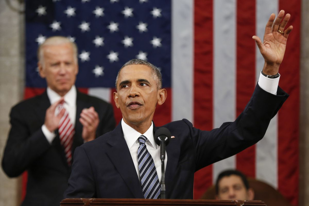 President Barack Obama at the conclusion of his State of the Union address, with Vice President Biden on the left.