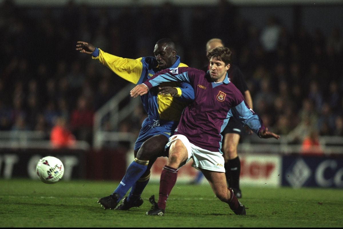Jimmy Hasselbaink of Leeds takes on John Moncur in a 50/50 ball