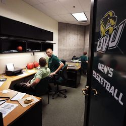 Utah Valley University men's basketball coach Mark Pope, right, works in his office in Orem with Assistant Athletic Director Todd Nebeker, Wednesday, April 29, 2015.