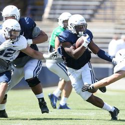 Adam Hine runs for yardage during a scrimmage at BYU in Provo on Saturday, Aug. 15, 2015.