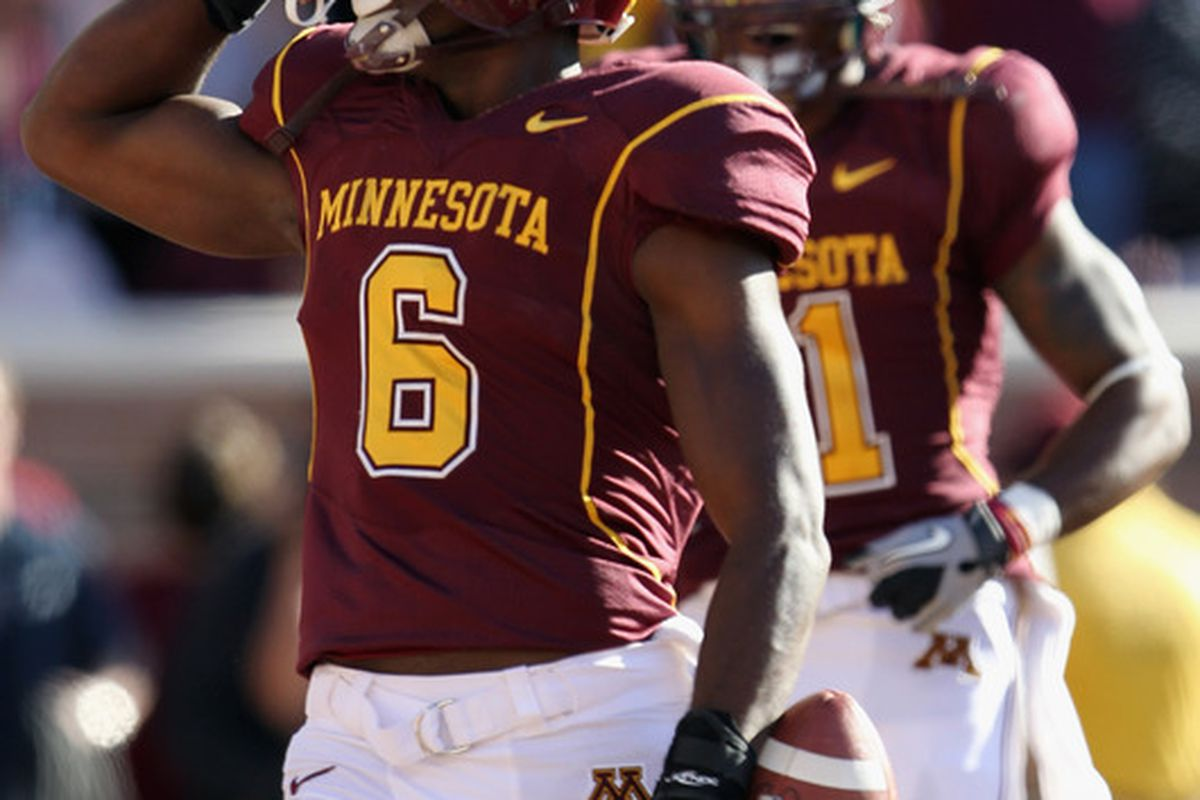 MINNEAPOLIS - SEPTEMBER 18:  Da'Jon McKnight #6 of the Minnesota Golden Gophers wipes a tear away against the USC Trojans on September 18 2010 at TCF Bank Stadium in Minneapolis Minnesota.  (Photo by Jamie Squire/Getty Images)
