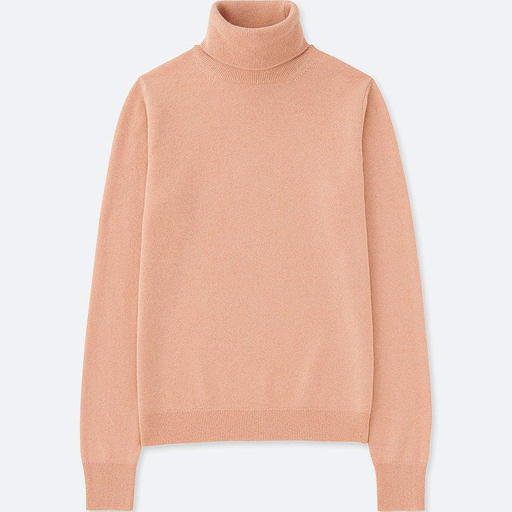 A pink cashmere turtleneck sweater