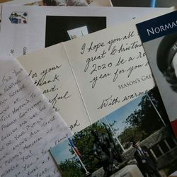 In this photo taken on Tuesday, May 5, 2020, showing correspondence between student Jonas Rocand, 14, and British WWII veteran Ken Cook, in Gonneville sur Mer, Normandy. As V-E Day approached, students in the Normandy region thought of 94-year-old veteran Bill Ridgewell and other vets living in isolation because of the COVID-19 pandemic — just as they were. The teens decided to swap stories with the men about their lives under lockdown.
