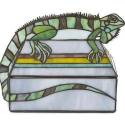 Don't be scared. It's just a leaded glass replica of an iguana, estimated to go for under $200.