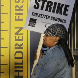 Chicago teacher Alma Hill walks a picket line outside Benjamin Banneker Elementary School in Chicago, Monday, Sept. 10, 2012, after the teachers went on strike for the first time in 25 years. Union and district officials failed to reach a contract agreement despite intense weekend negotiations.