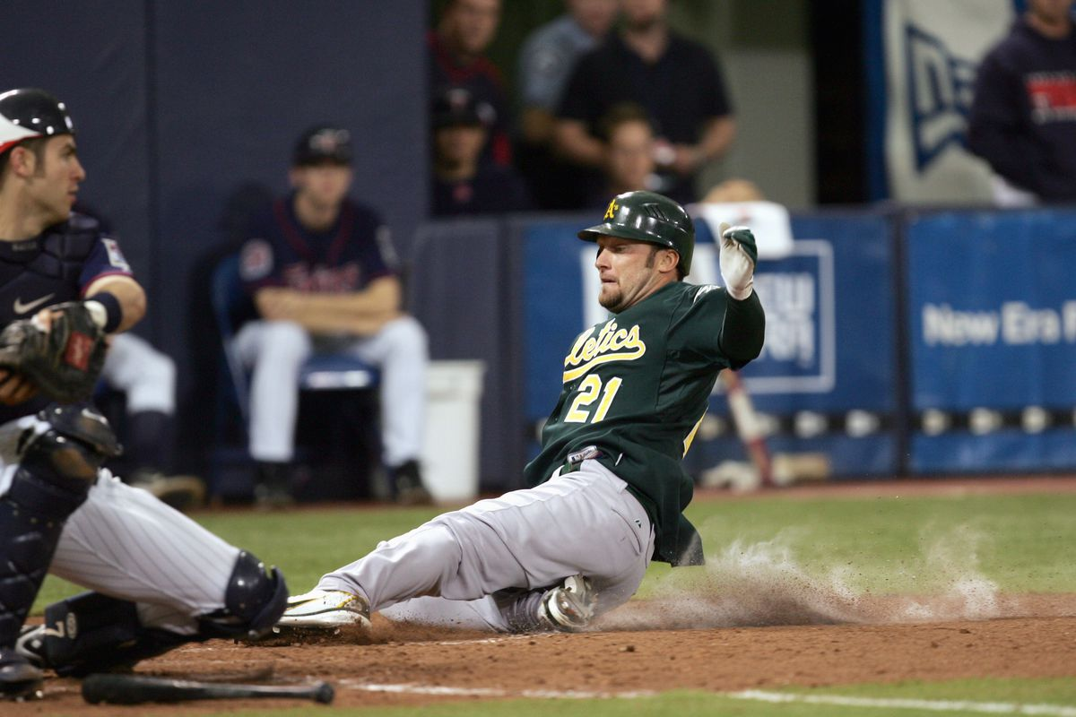 Mark Kotsay scores for the Oakland Athletics on his two-run inside the park home run for the Athletics in Game 2 of the 2006 ALDS.