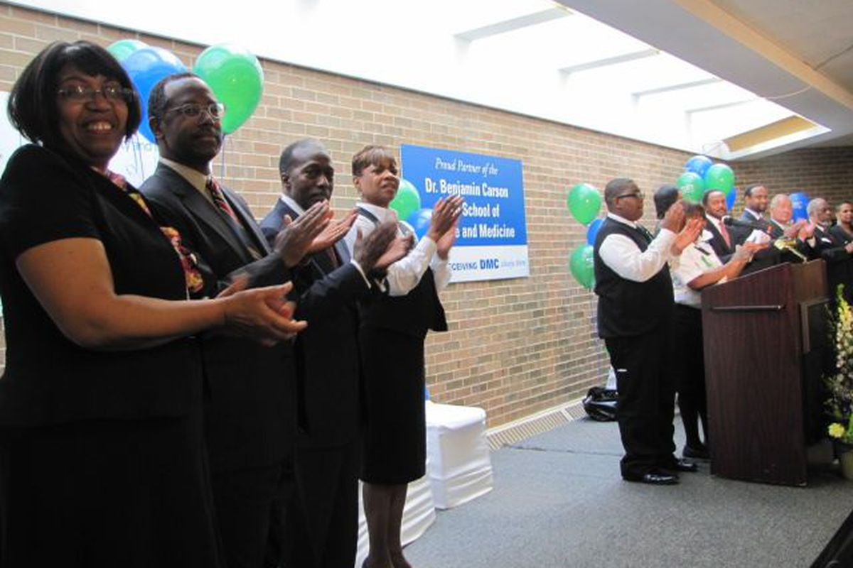 Ben Carson, second from left, and Roy Roberts, then the state-appointed emergency manager of Detroit public schools, at the 2011 ribbon cutting for the Detroit high school named after Carson.