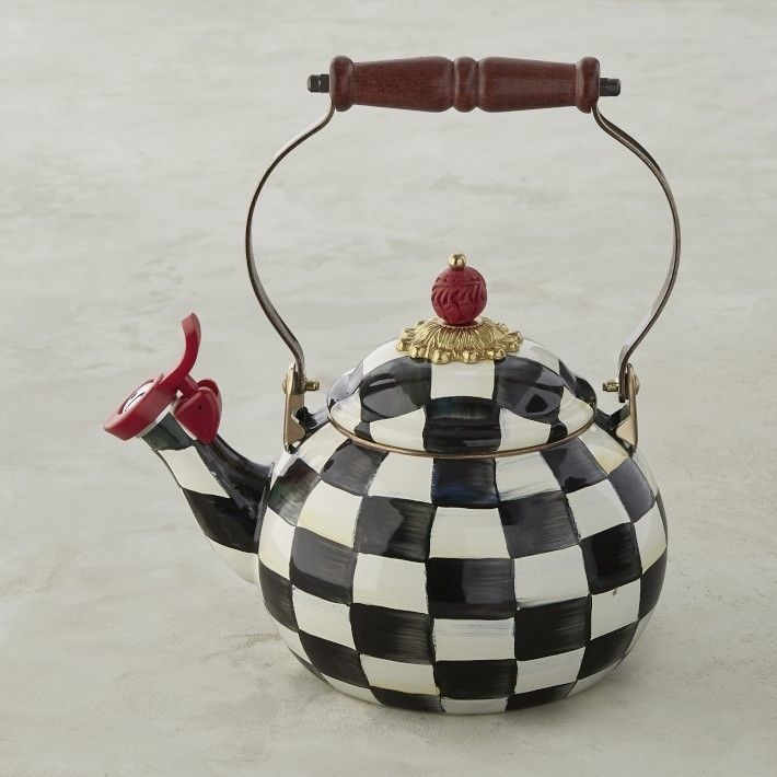 A tea kettle in a black and white checkered pattern