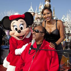 """Shown here in 2009 at the Disney Parks Christmas Day Parade at Disneyland in Anaheim, California, musician Stevie Wonder posed with his daughter Aisha, for whom he wrote his song """"Isn't She Lovely."""""""