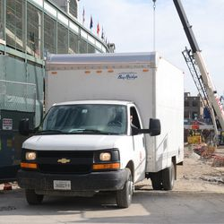 4:33 p.m. Contractor truck moved out of the way and parked on the triangle lot -