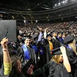 Students celebrate after Salt Lake Community College's commencement ceremony at the Maverik Center in West Valley City on Friday, May 6, 2016.