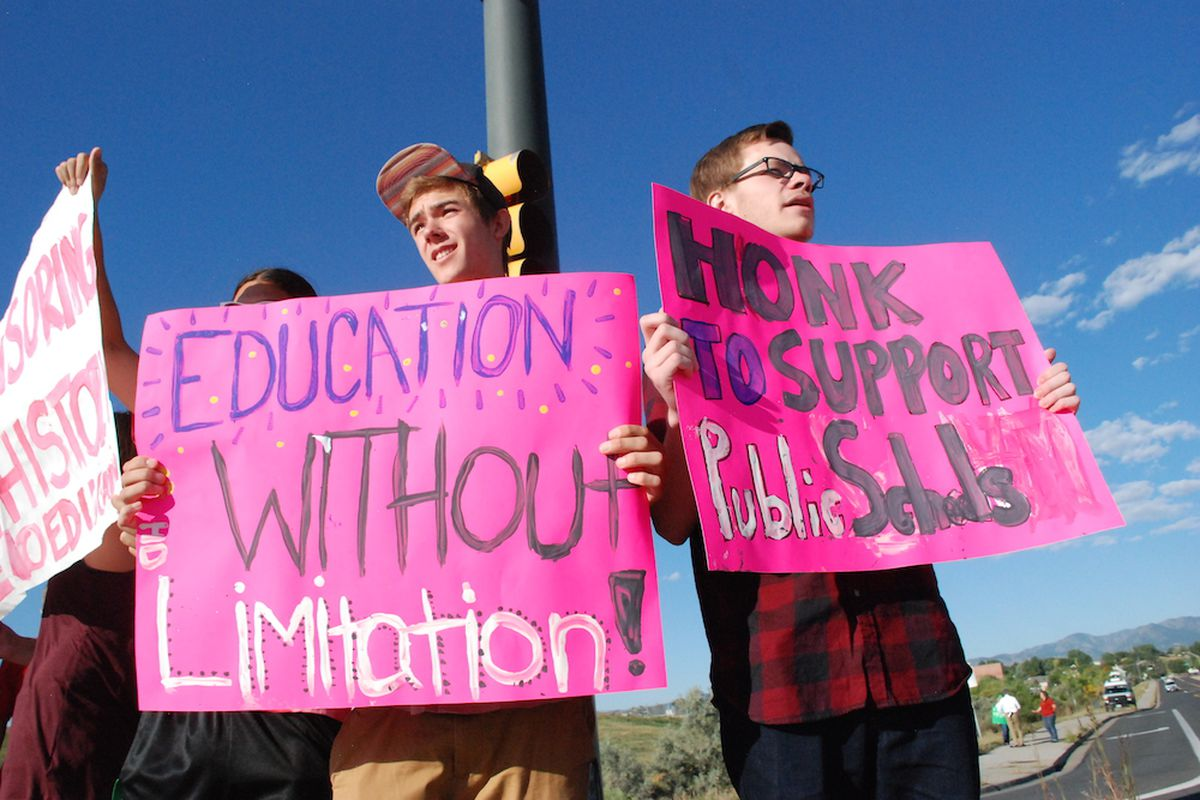 """Standley Lake High School students rallied near their school Sept. 19, 2014, to raise awareness over a proposed curriculum panel that would report to the school district's Board of Education. The rally was the same day as an apparent teacher """"sick out."""""""