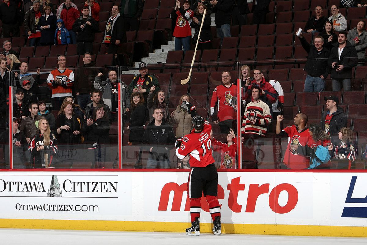 """A concerned fan throws Jason Spezza his stick back after last night's game, deciding """"Spezza needs it more."""""""