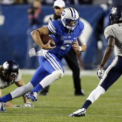 Christian Stewart (7) of the Brigham Young University Cougars runs against USU during NCAA football in Provo, Friday, Oct. 3, 2014.