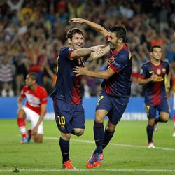 Barcelona's Lionel Messi from Argentina, center left, celebrates with teammate David Villa after scoring during a Champions League Group G soccer match against Spartak Moscow at the Camp Nou Stadium, in Barcelona, Wednesday, Sept. 19, 2012.