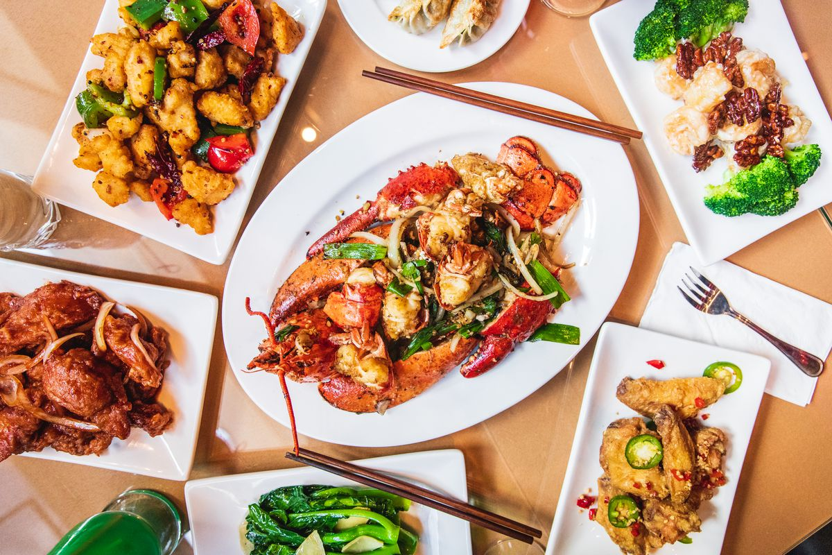 A variety of plates of Chinese food.