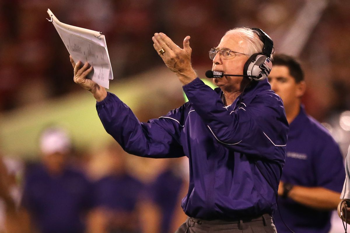 Bill Snyder demonstrates how K State's rankings have gone this season.