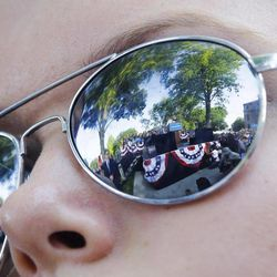 President Barack Obama is reflected in Megan Malin's, 14, sunglasses during a campaign event at Morningside College, Saturday, Sept. 1, 2012, in Sioux City, Iowa.