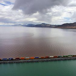 A train rolls eastward on the causeway for Union Pacific in the Great Salt Lake. Colors show brilliantly in the water on both sides of the causeway west of the Promontory Peninsula, Wednesday, June 8, 2011.