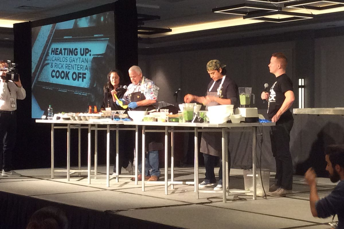 """Chicago White Sox manager Rick Renteria participates in a cooking competition against """"Top Chef"""" Carlos Gaytan."""