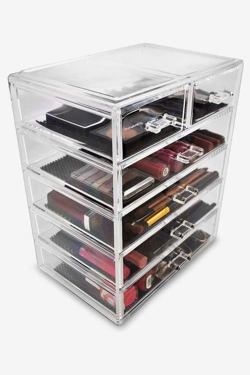 Tall clear container with multiple drawers.