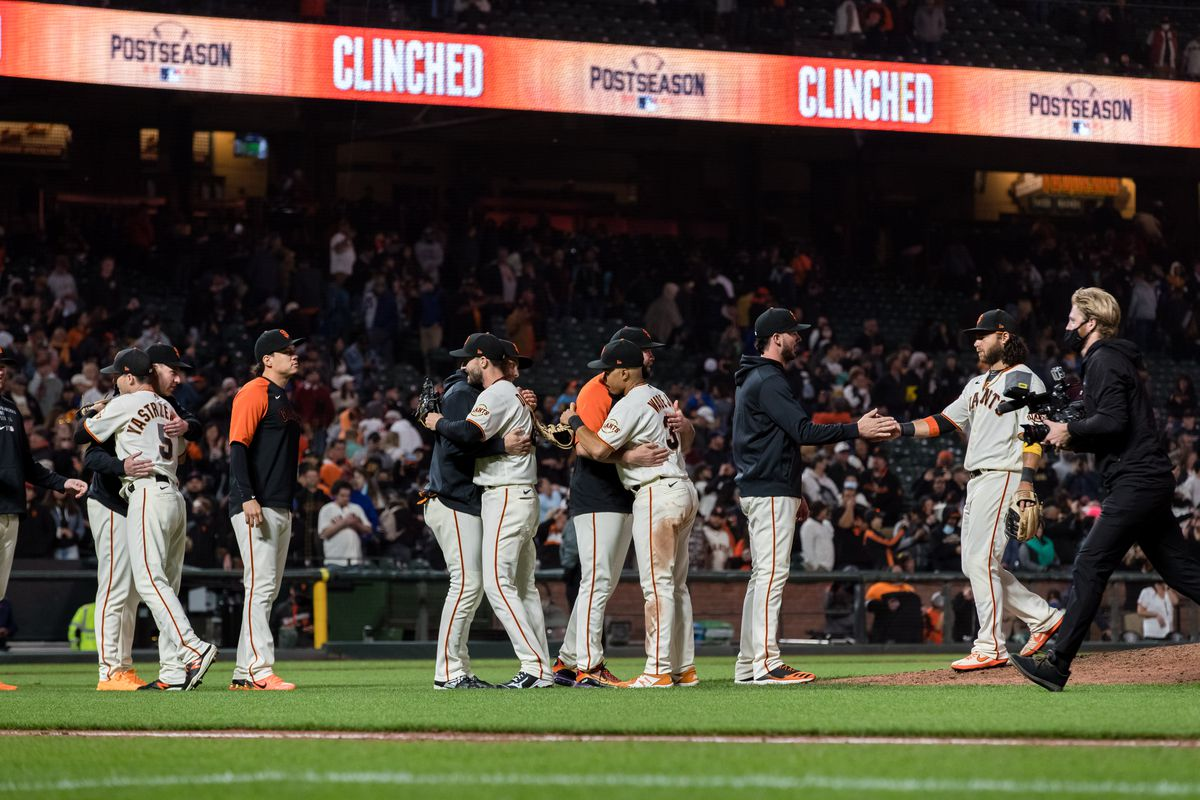 The San Francisco Giants celebrate after defeating the San Diego Padres at Oracle Park.