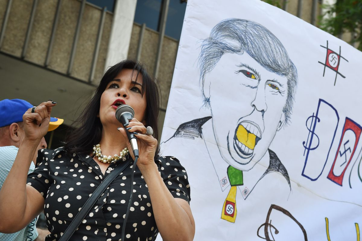 Activist Laura Padilla joins a coalition of Latino community leaders as they protest against the policies of Republican presidential hopeful Donald Trump, outside the Federal Building in Los Angeles, California on August 19, 2015. Trump's policy plan for