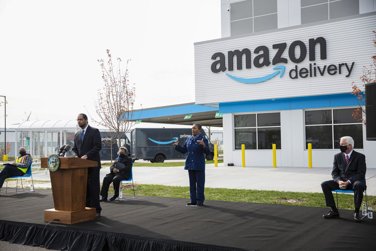 Ald. Anthony Beale (9th) speaks Wednesday about the efforts to bring Amazon to the Pullman community. Beale and Mayor Lori Lightfoot (seated, background) attended the ceremonial opening of Chicago's first Amazon Delivery Station, 10500 S. Woodlawn Ave in Pullman.