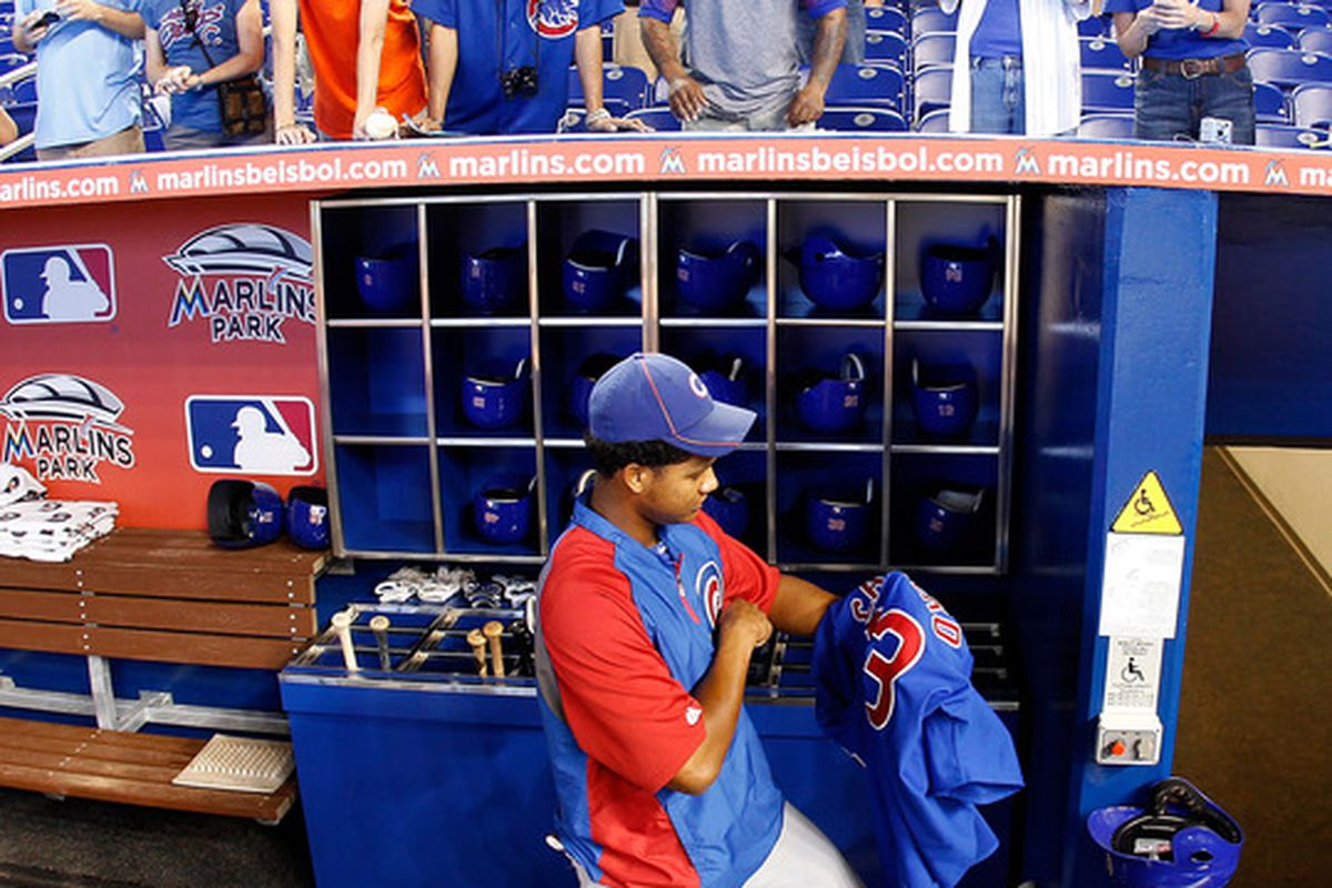 Starlin Castro of the Chicago Cubs signs an autograph before a game against the Miami Marlins at Marlins Park in Miami, Florida.  (Photo by Sarah Glenn/Getty Images)