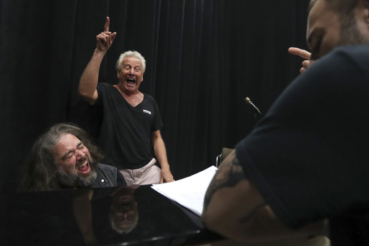 """Air Supply's Graham Russell, center, and musical director Jonathan Ivie, left, sing the high notes they want actor John Patrick McKenna to hit during rehearsal for the musical """"A Wall Apart."""""""