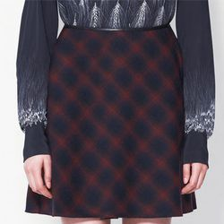 "<b>3.1 Phillip Lim</b> Sculpted Flare Skirt, <a href=""http://www.31philliplim.com/shop/category/womens/skirts#sculpted-flare-skirt-navy-multi"">$375</a>"