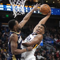 Utah Jazz guard Donovan Mitchell (45) attempts to dunk over New Orleans Pelicans guard Tony Allen (24) as Utah hosts New Orleans at Vivint Arena in Salt Lake on Friday, Dec. 1, 2017.