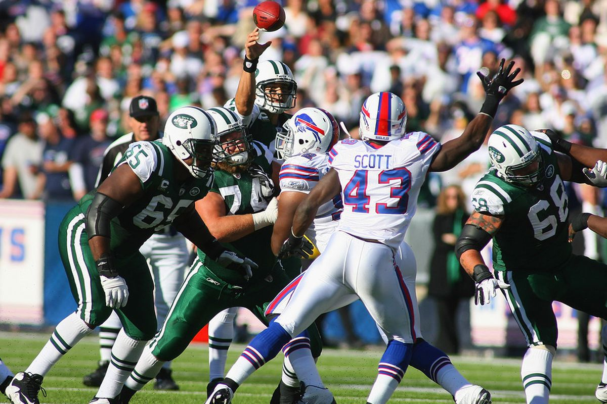 ORCHARD PARK, NY - NOVEMBER 06:  Mark Sanchez #6 of the New York Jets throws a pass against the Buffalo Bills at Ralph Wilson Stadium on November 6, 2011 in Orchard Park, New York.  (Photo by Rick Stewart/Getty Images)