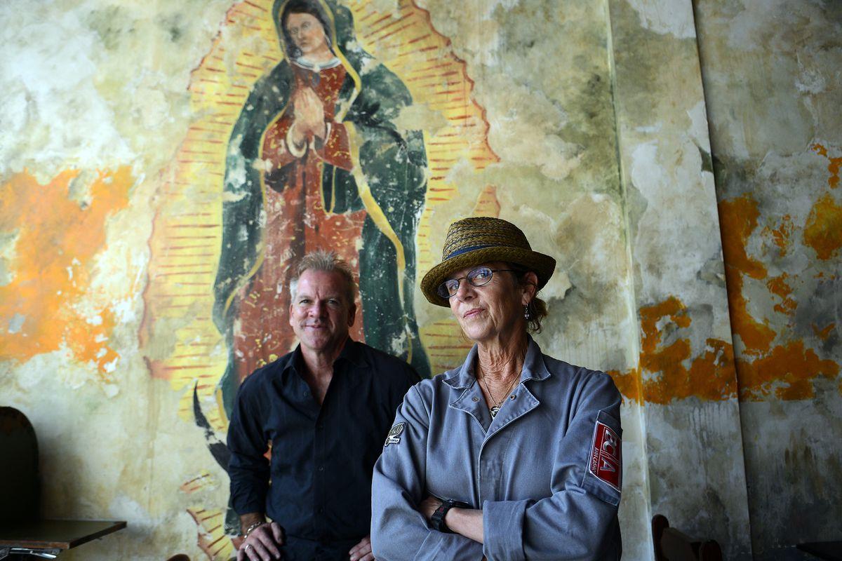 Chef Ann Cashion and John Fulchino pose for a portrait.