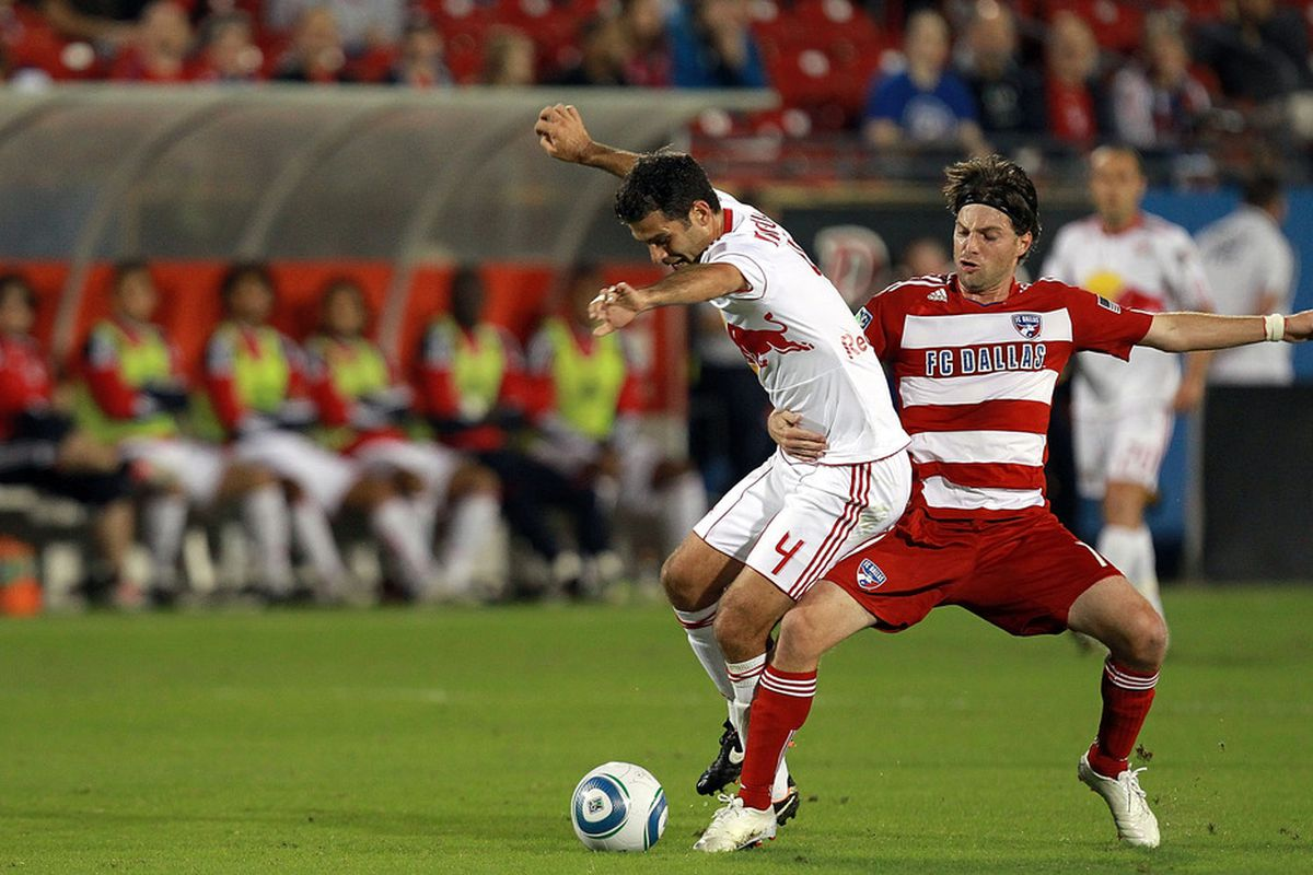 FRISCO, TX - OCTOBER 26: Rafa Marquez #4 of the New York Red Bulls dribbles the ball against Ricardo Villar #11 of the FC Dallas at Pizza Hut Park during a wild card match on October 26, 2011 in Frisco, Texas.  (Photo by Ronald Martinez/Getty Images)