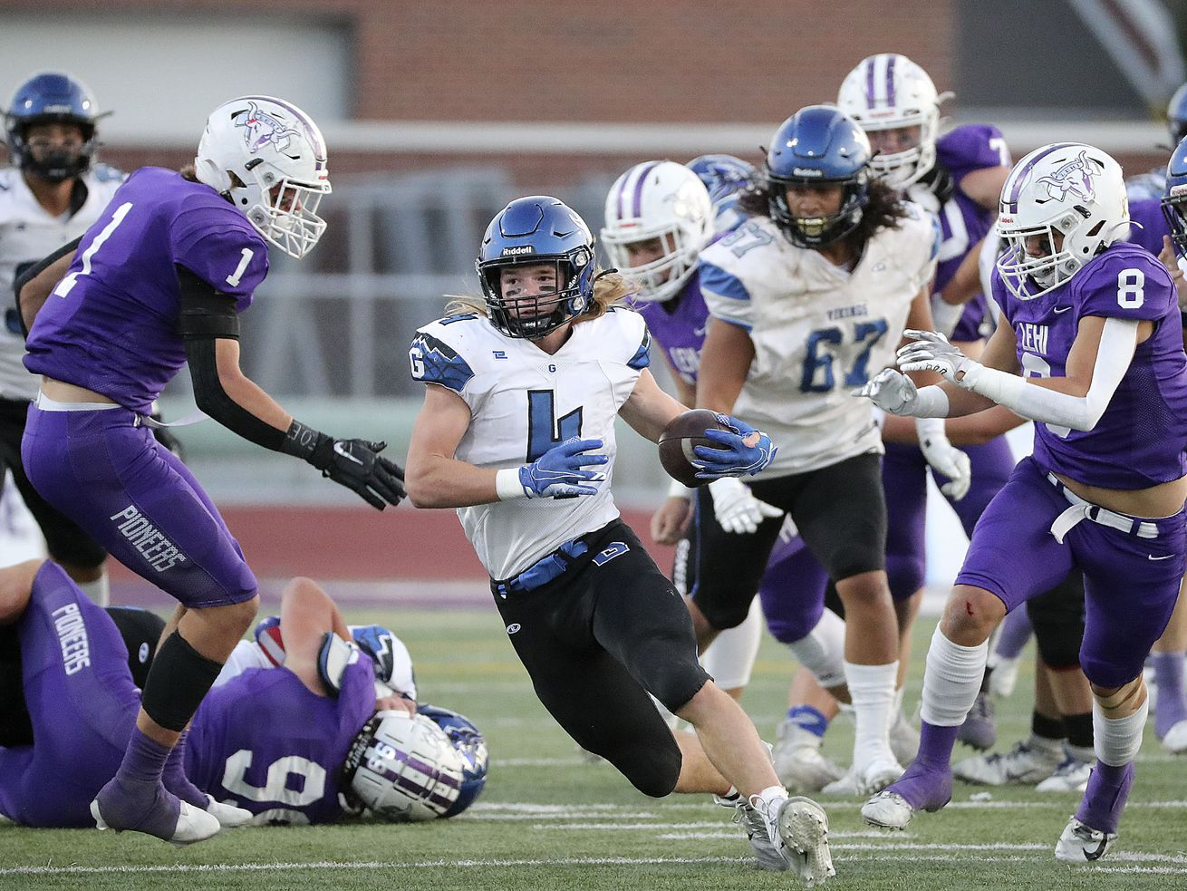 Pleasant Grove's Rex Connors runs with the ball during a football game against Lehi at Lehi High School in Lehi on Friday, Sept. 11, 2020.