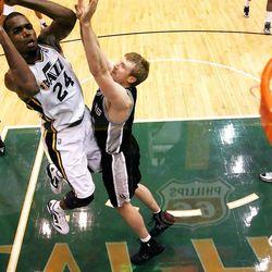 Utah Jazz forward Paul Millsap (24) shoots over San Antonio Spurs forward Matt Bonner (15) as the Utah Jazz and the San Antonio Spurs play Monday, Feb. 20, 2012 at Energy Solutions arena in Salt Lake City. Spurs won 106-102