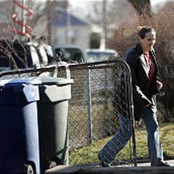"""Ajaka Omerovi, an aunt of suspected Trolley Square gunman Sulejman Talovic, stops by the Talovic home in West Salt Lake Tuesday afternoon. """"He was a nice boy,"""" Omerovi told reporters about her nephew."""