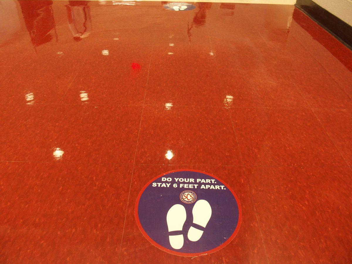 A social distancing floor marker in a Memphis school building