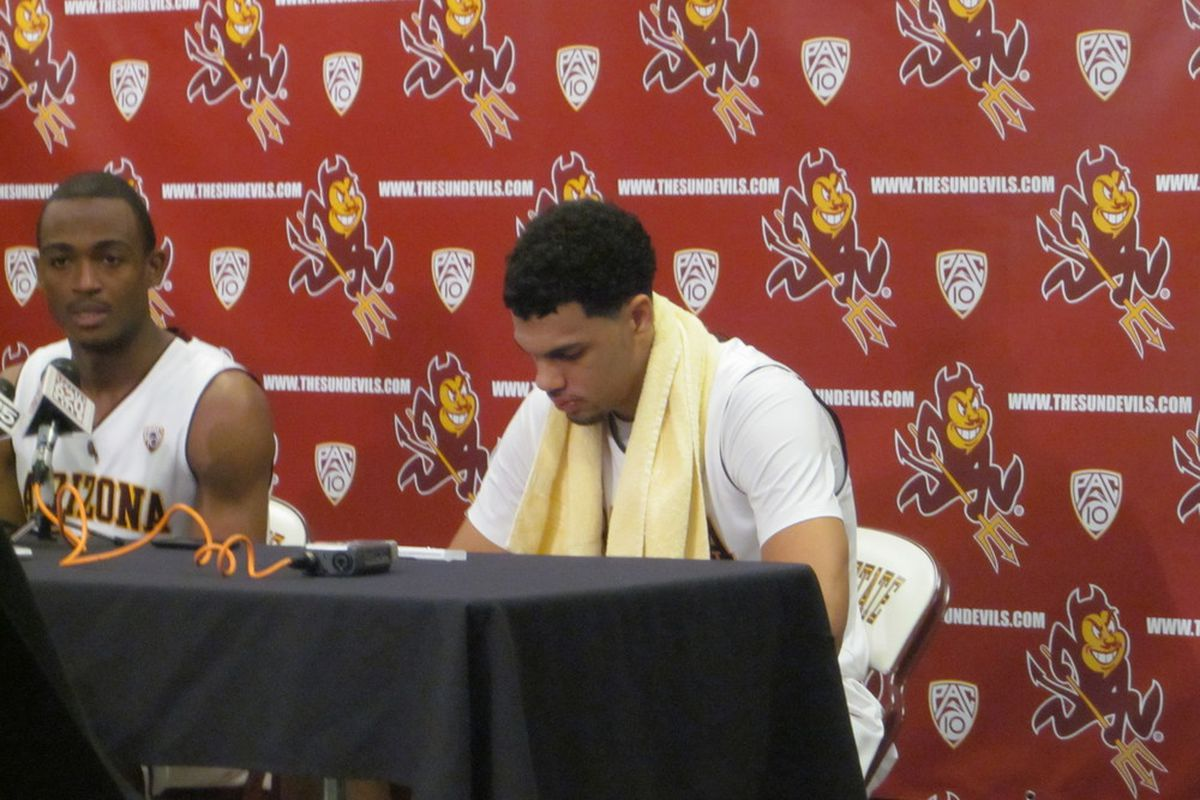 Jamelle McMillan addresses the media while Trent Lockett looks bummed out after ASU's 73-72 loss to UCLA. (photo by Jose Romero, SB Nation Arizona).