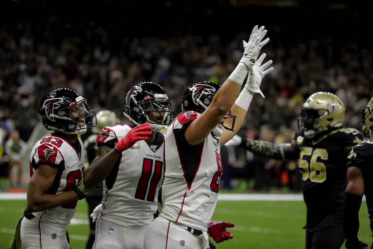 Atlanta Falcons tight end Austin Hooper celebrates with wide receiver Julio Jones and wide receiver Russell Gage after scoring a touchdown against the New Orleans Saints during the first half at the Mercedes-Benz Superdome.