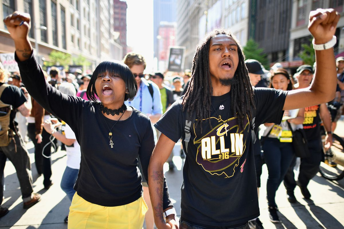 Protesters march in downtown Cleveland during the Republican convention.