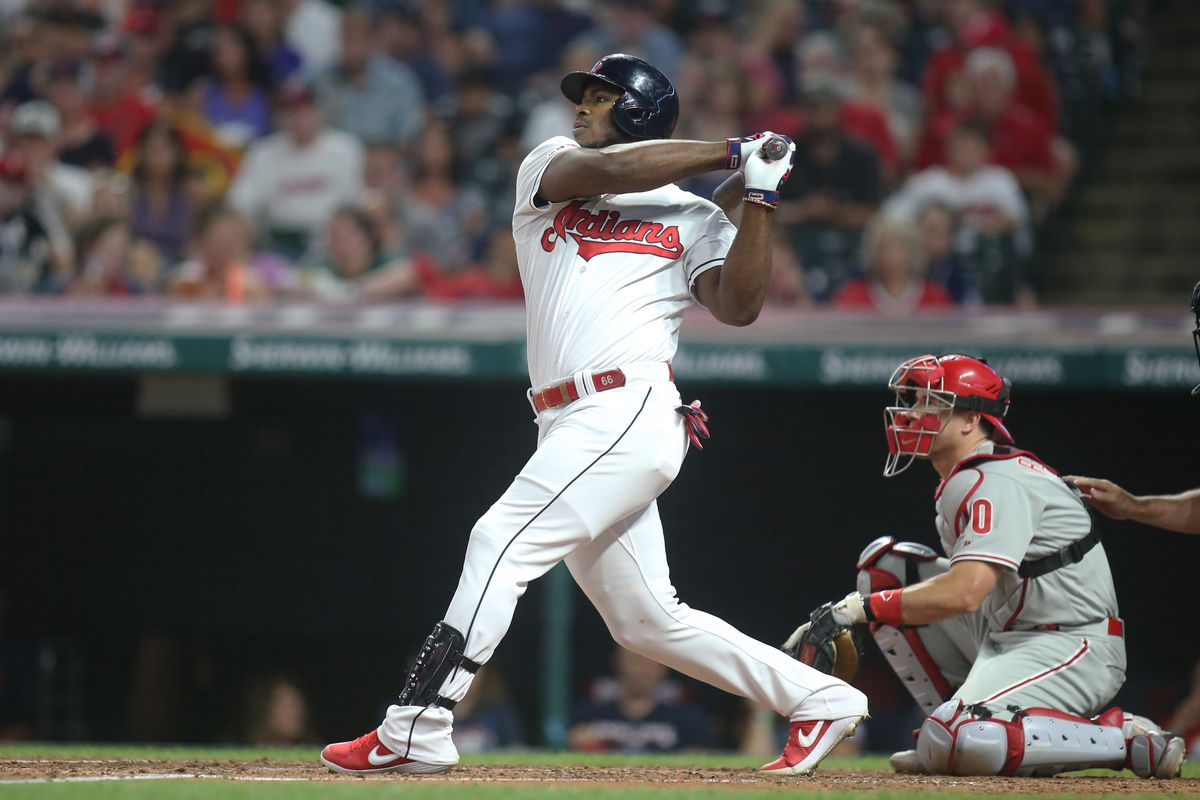 Cleveland Indians right fielder Yasiel Puig singles against the Philadelphia Phillies during the fourth inning at Progressive Field.