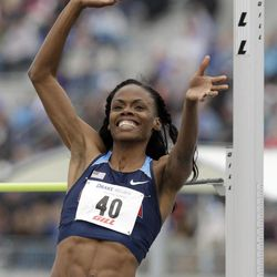 Chaunte Lowe reacts after clearing the bar during the women's special high jump at the Drake Relays athletics meet, Saturday, April 28, 2012, in Des Moines, Iowa.